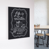 Use foam adhesive pads to secure wall mounted chalkboards