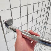 These corner clothes rails slot onto grid mesh panels in seconds