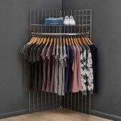 Use a corner clothes rail with grid mesh panels for retail clothing displays