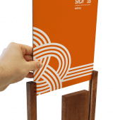 Slide a poster directly into the wooden grooved columns