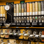 Wall mounted gravity food dispenser for refill shop supplies