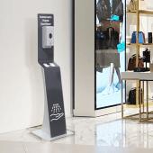 Freestanding hand sanitiser station in use