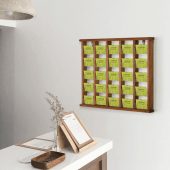 Display cards or leaflets with a wooden wall mounted leaflet rack