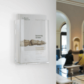 Wall mounted leaflet holder