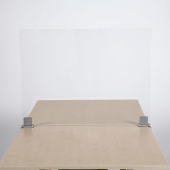 A desk screen protects employees and customers from each other