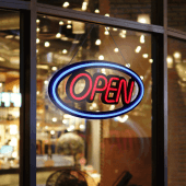 An LED neon open sign attracts passing custom, even on dark nights