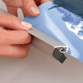 Ceiling poster gripper bars with snap shut mechanism