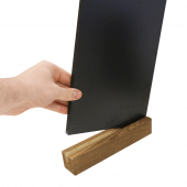 The chalkboard insert slots seamlessly into the stylish wooden base