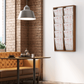 A wooden magazine wall display has a stylish rustic aesthetic
