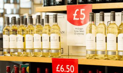 Unusual price holders for shops, including pallet signage and reusable bottle neck labels