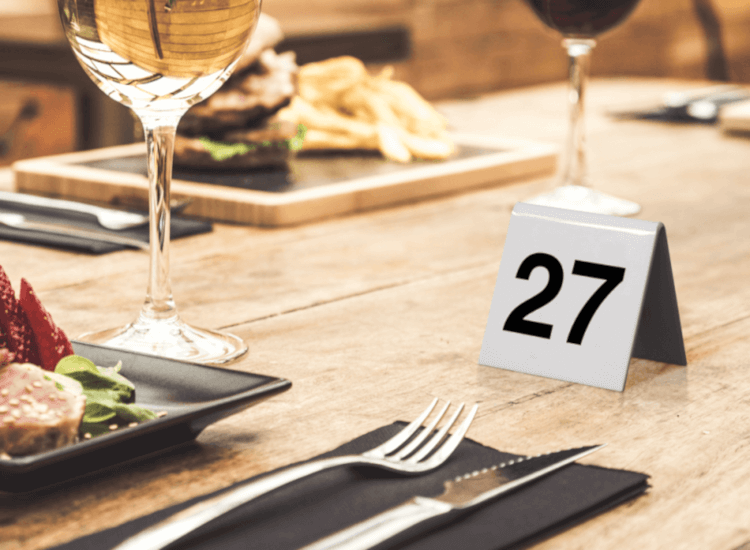 acrylic table numbers and other tabletop hospitality supplies used in a restaurant display