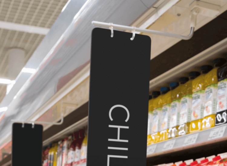 Use aisle signs to influence customers