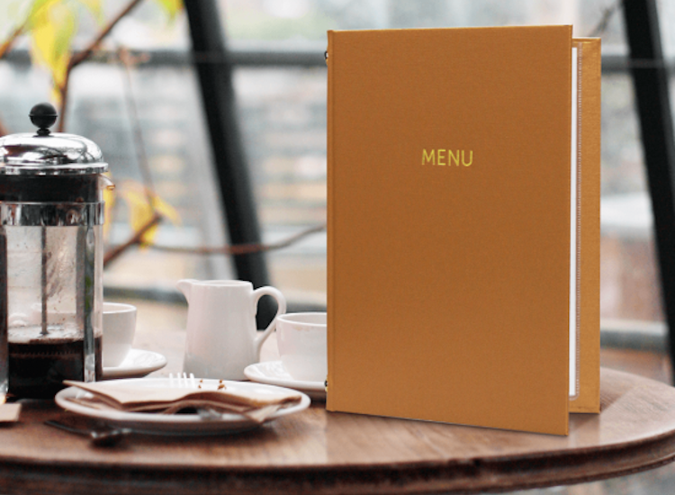 Buckram menu cover stood upright on a table. High end menu covers with a modern feel