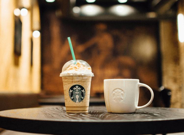 Ceramic and plastic cups featuring the Starbucks logo
