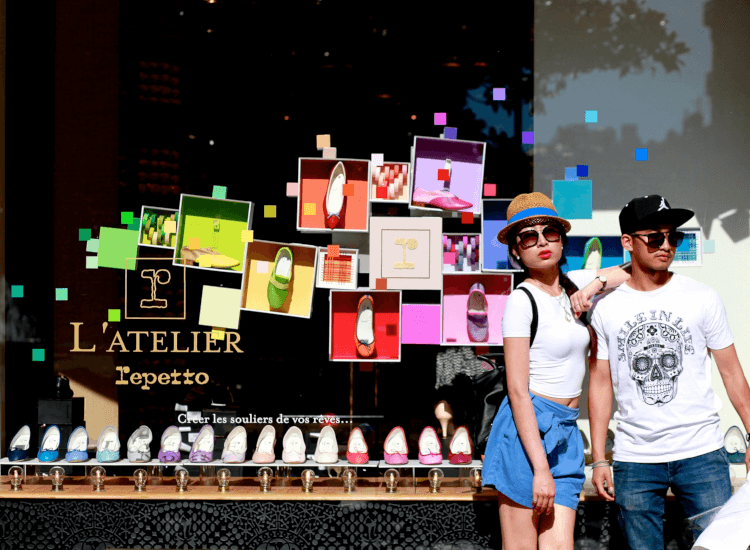 Young couple posing next to colourful shop window