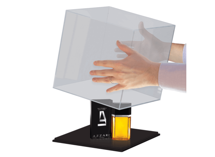 Clear display case being lifted to reveal a luxury product