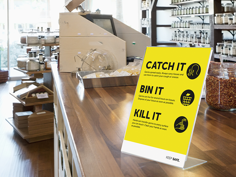 A Catch It, Bin It, Kill It poster in a homeware retail store