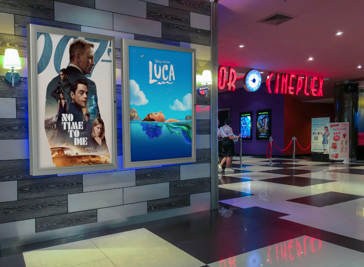 backlit posters at a cinema