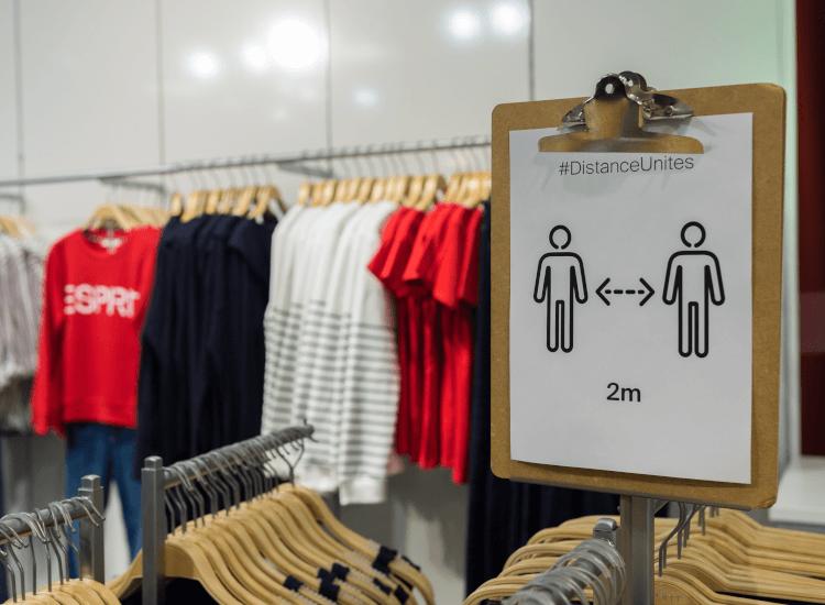 clothes shop social distancing sign