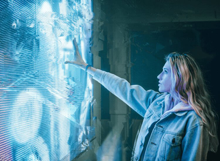 Blonde woman reaching out to interactive touchscreen