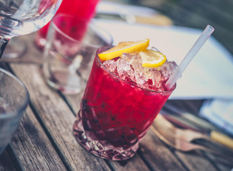 Cocktails at an outdoor bar: Millennials claim to spend more money on alcohol when dining outdoors, according to research. Include outdoor bars in your outdoor seating ideas
