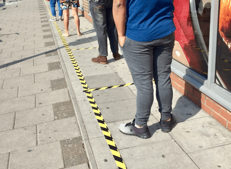 socially distanced queuing system made using floor tape