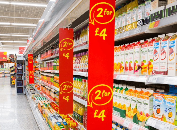 Red aisle signs over supermarket shelving
