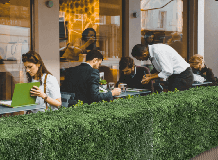 Use a faux hedge to create an beautiful outdoor dining area. Restaurant hedge has a fresh feel while being low maintenance.