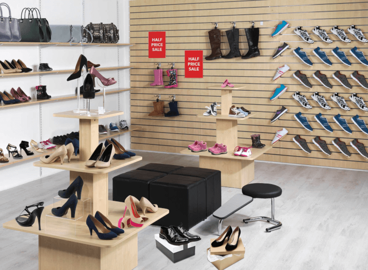 Slatwall and twinslot shelving in retail for flat shelf signs