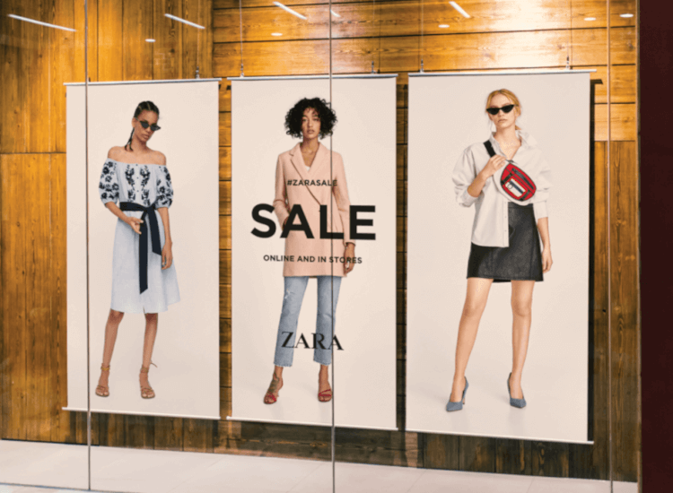 Overhead posters to influence customer behaviour