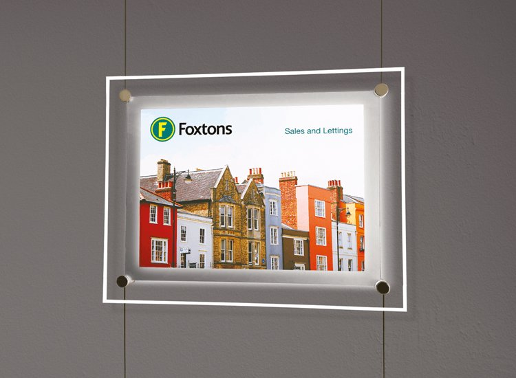 Printed posters for estate agent window displays