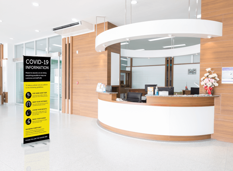 returning to the workplace COVID 19 reception desk roller banner