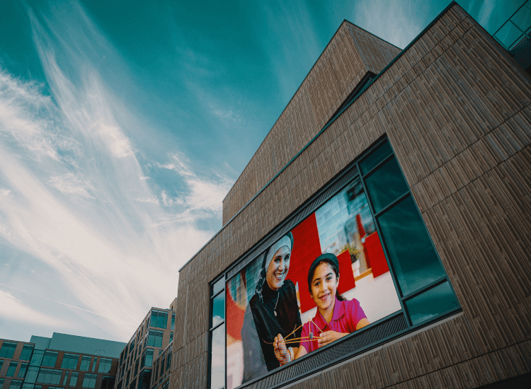 Digital display board ideas 1: family pictured on an outdoor digital screen