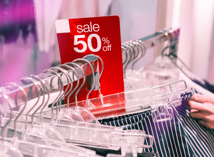 Garment rail with fifty percent off sale sign