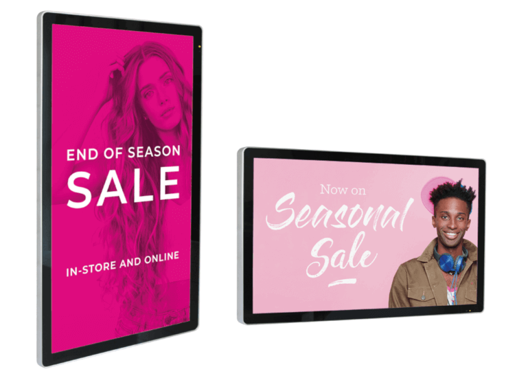Wall mounted digital signs displaying sale information