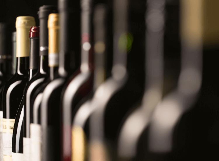 Layered wine bottle window display