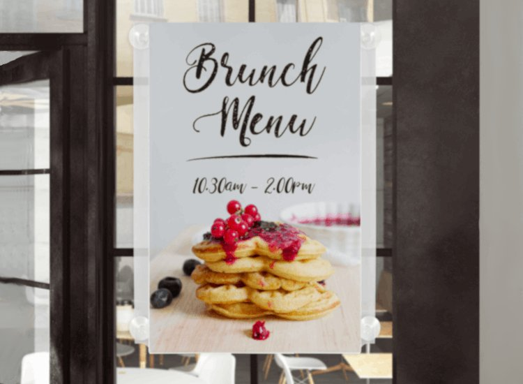 Window poster holder showing brunch times, a crucial form of window merchandising for cafes and restaurants.